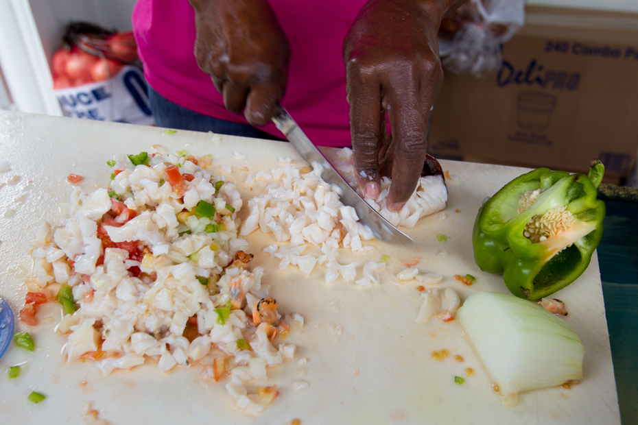 Conch Salad Bahamas preparation. Discover the many conch recipes caribbean