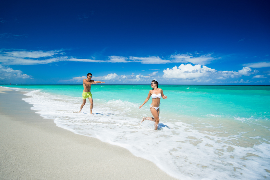 Couple of beautiful woman and man are running on the beach of caribbean sea at summer sunny day. Check out this Miami to Bahamas flight on a Bahamas charter you've always dreamed of. Imagine yourself on one of our flights from Miami to Nassau or other flights to Bahamas ready to enter paradise. Our Florida to Bahamas flights are one of the best day trips in Florida. Bahamas Air Tours gives you your guide to Day Trips to Bahamas by flights to Bahamas aboard Bahamas Air Charters to Swimming Pigs tours and the Exuma pigs on Pig Island at Pig Beach. Join one of our Staniel Cay Day trips on our Nassau to Staniel Cay day tour or opt for the Staniel Cay Day trips by the way of Bahamas Day Trips by plane. Trips to Bahamas to see pigs in Bahamas. Miami to Bahamas day trip is one of the top Florida attractions.
