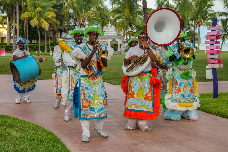 Bahamas music, such as Rake and Scrape, often incorporates traditional dress.