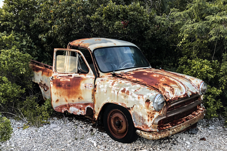 An old abandoned truck alongside a road on Staniel Cay Bahamas in the Exumas