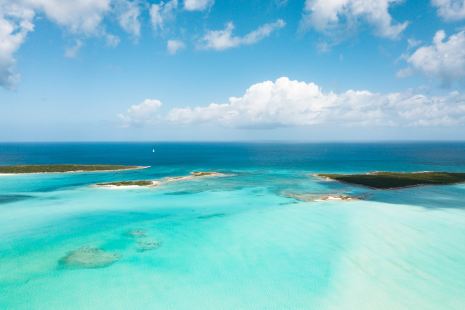 The turquoise waters of the Exuma out islands and cays in the Bahamas. The Staniel Cay resort and Exumas resorts are perfect to witness the Bahamas vacation beauty.