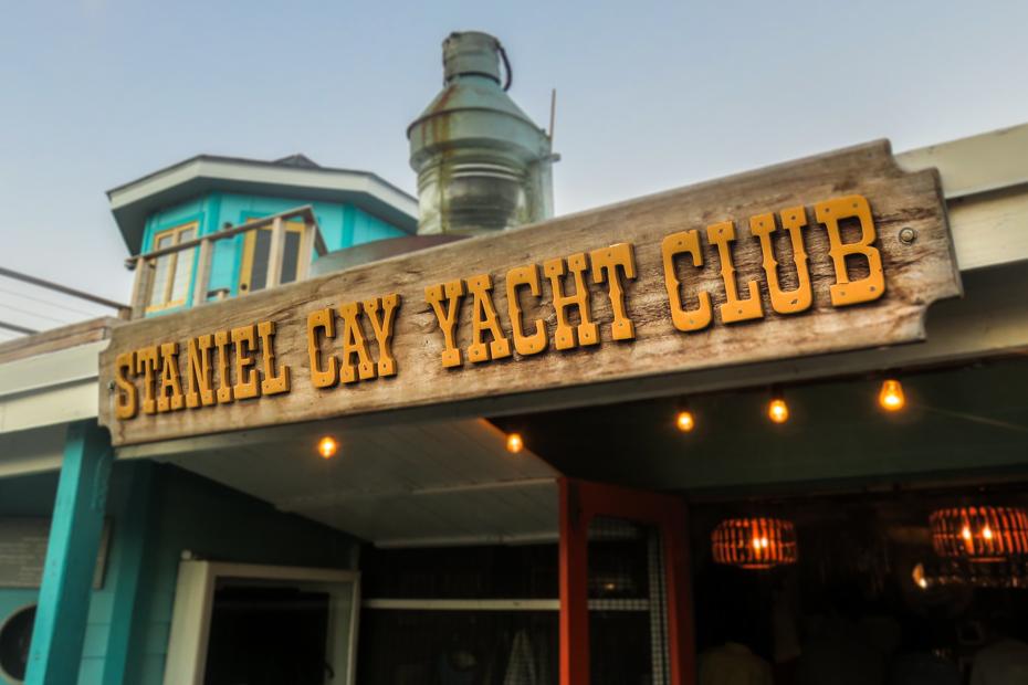 The original Staniel Cay Yacht Club sign at the Bar Entrance at Staniel Cay in the Exumas Bahamas.
