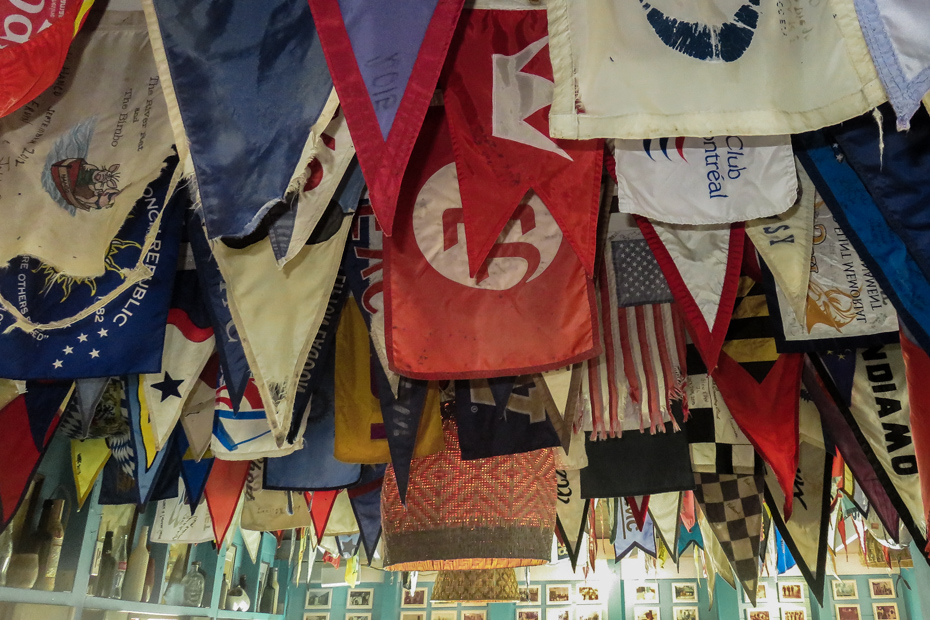 Yachting flags adorn the ceiling of the Staniel Cay Yacht Club Bar in Staniel Cay Exumas.