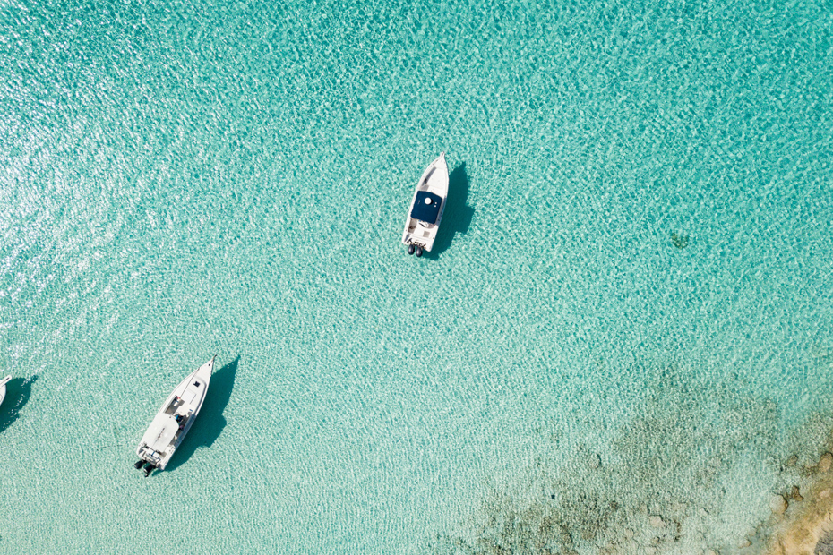 Aerial view of Bimini waters. Taking a Bimini cruise to Bimini Bahamas? This guide will go over one day cruise to Bimini itineraries.