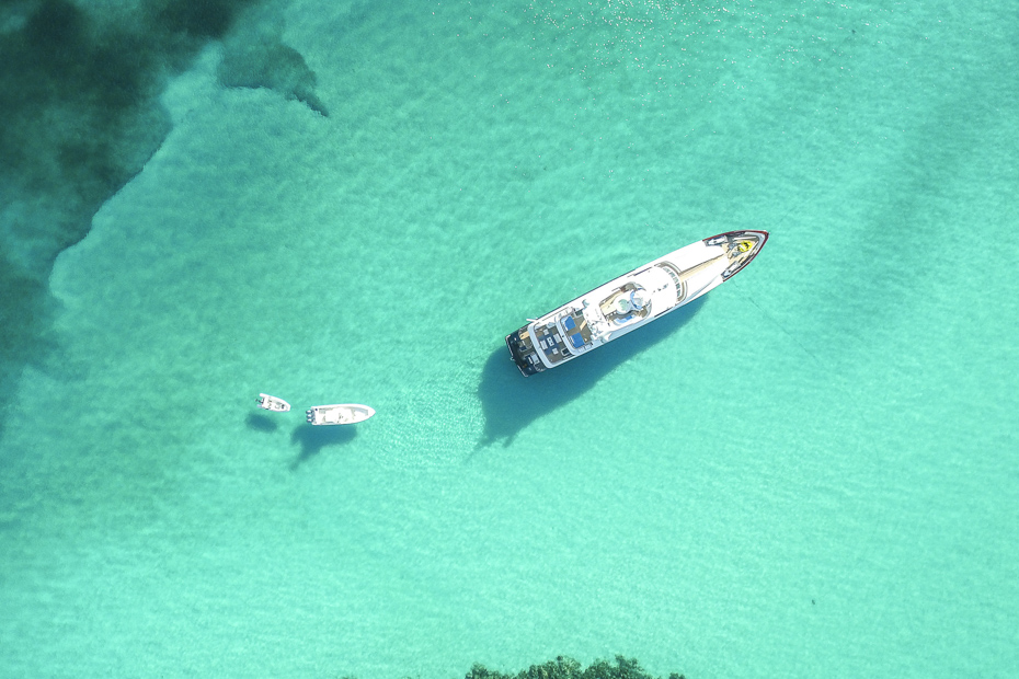 Aerial view of the crystal clear waters of Great Harbour Cay. Check out pigs in the Bahamas on a Florida to Bahamas vacation today.
