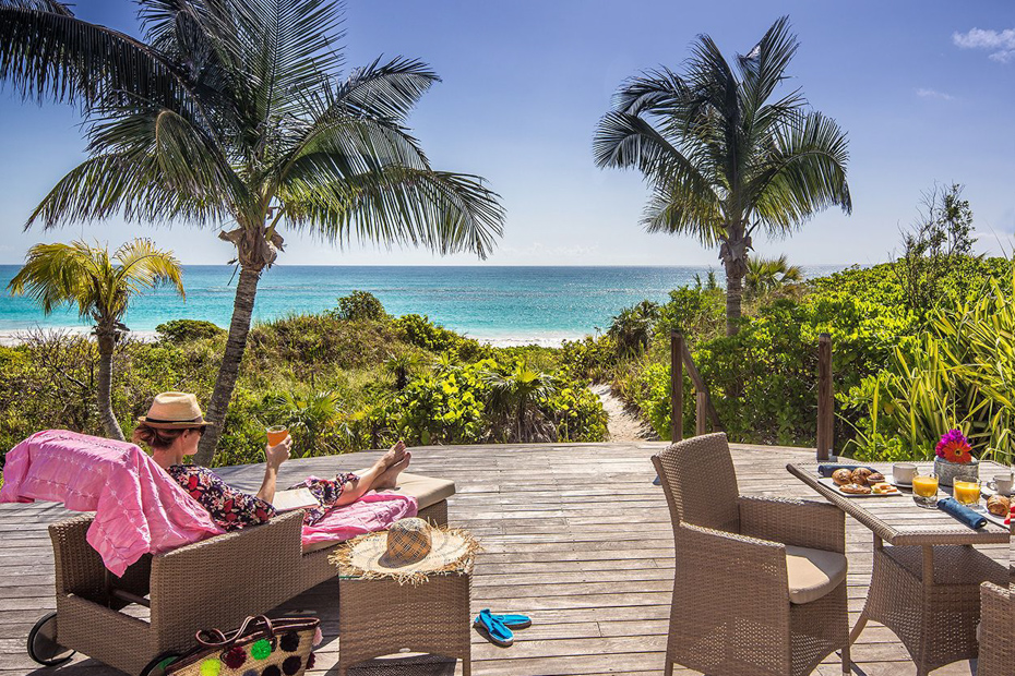 Relax by the beach. Harbour Island Bahamas, home of Pink Sands Resort at Pink Sands Beach on Eleuthera Island is one of the most visited in the entire country.