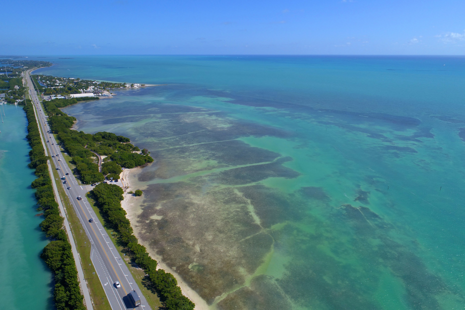 Aerial image of the Overseas Highway in the Florida Keys. One of the best things to do in Miami Florida is cruise this coastal highway through south florida.