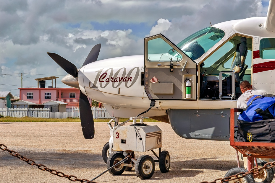 A Cessna private Bahamas air charter about to take off. It flies Day trip to Bahamas from Miami Florida every day for tourists going on swimming pigs tours.