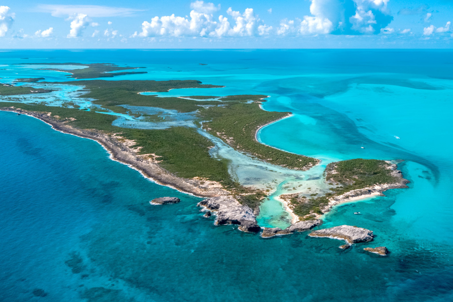 Aerial shot of the Exuma Cays. Nassau to Pig Beach Bahamas day trip. Flying a private Bahamas air charter.