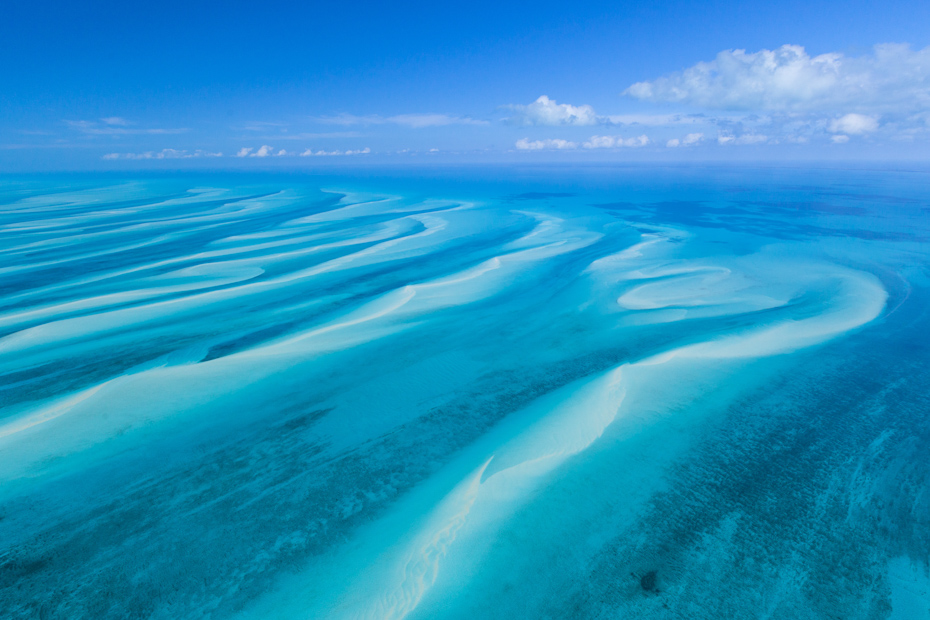 A canvas of vibrant blues is typical of the Bahamas. Shot from day trip to Bahamas by plane on a one day trip to Bahamas.