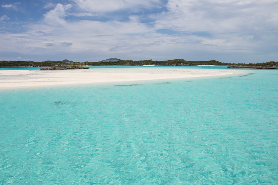 An oasis in the Exuma Cays. Millions of tourists go swimming with the pigs at Pig Island every year on Bahamas day tours to Pig Beach.