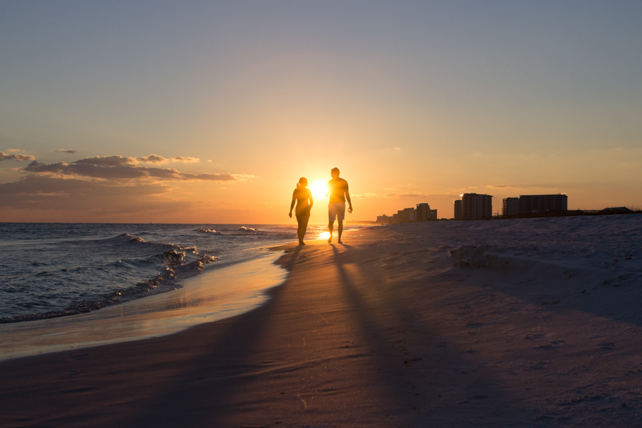 A romantic beach stroll at sunset. One of the best things for couples to do in Orlando Florida beaches.