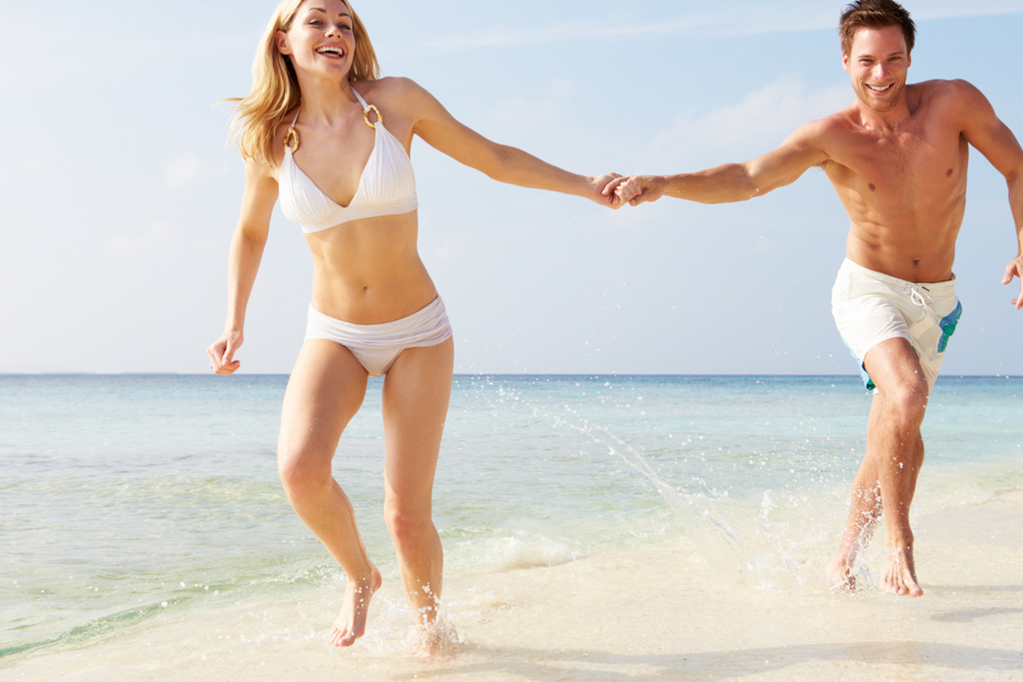 Couple on a romantic beach stroll in South Florida. Florida beaches are things to do in Orlando Florida on your Florida vacation.