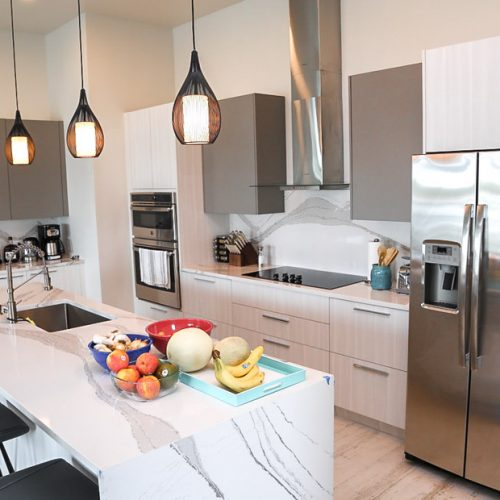 The full sized kitchen in one of 3 luxury water villas at Staniel Cay. These rentals on Staniel Cay are the perfect base for exploring the Bahamas and Exuma islands.