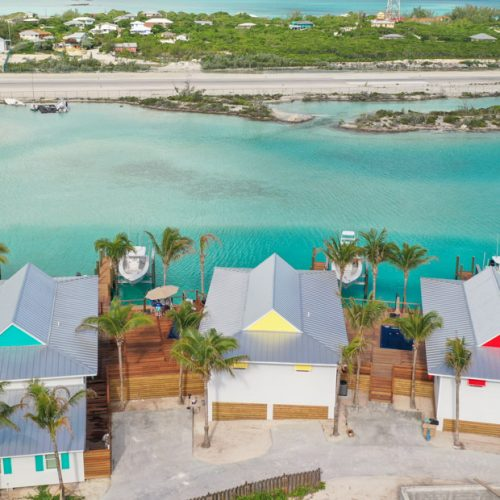 The villas at Staniel Cay Lagoon in Exuma Bahamas. 3 Luxury water villas to stay in for your Bahamas Vacation.