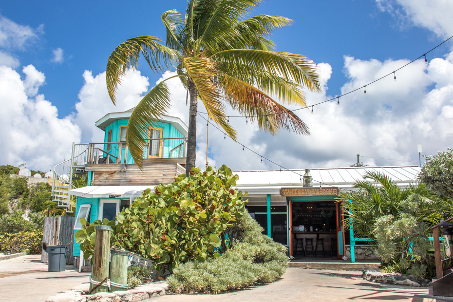 Staniel Cay is the best island to stay in Bahamas. Located in the Exuma Cays, Staniel Cay is closest island to Pig Beach and has many stnaiel Cay accommodations. Pictured is the Staniel Cay Yacht Club SCYC, a luxury boutique hotel on Staniel Cay Exuma.
