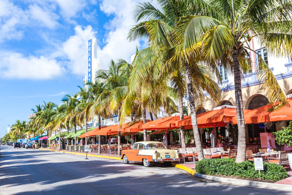 What to do in south beach miami Ocean Drive home to the Art Deco Edison Hotel and a classic oldsmobile car on Ocean Drive, South Beach, Miami, USA. Ocean drive has almost all of the top things to do in Miami Beach