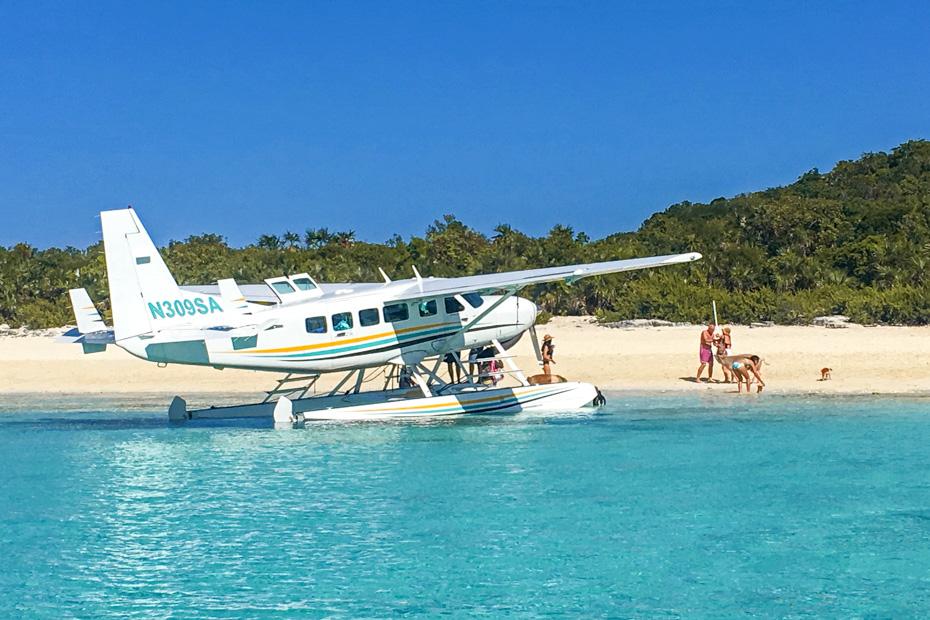getting to exuma pig beach at Staniel Cay. Fly from Nassau to exuma pig beach on the Bahamas Air Tours Nassau to Exuma Day Trip. Pig Beach in on an island called Big Major Cay in the Bahamas Exumas
