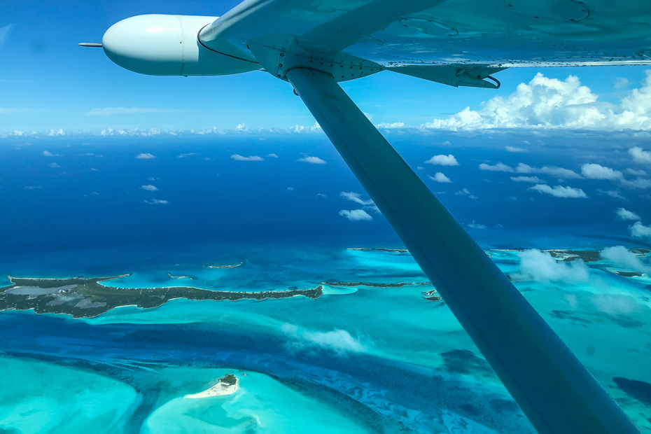 Aerial view of the exotic Exuma Cays in the Bahamas. Take day trips from Nassau to Exuma to see the pigs in the Bahamas with Bahamas Air Tours.