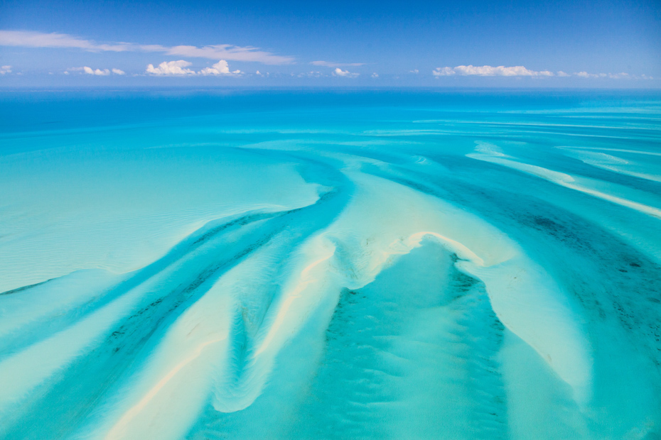 Aerial view over the Exuma Cays. A day trip to Bahamas from Miami in a private Bahamas Air Tours VIP plane.